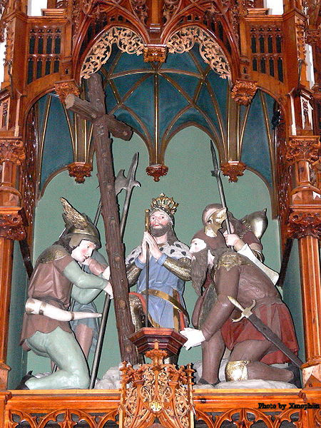 St. Oswald and his men praying before the wooden cross made before the Battle at Bede Denis-burn. This carving is over the Main altar of the 14th century Church of St. Oswald bei Haslach in Upper Austria.