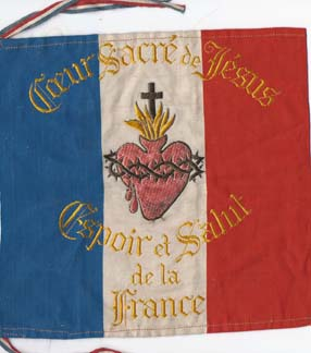 """The Flag of Sacre-Coeur, borne by the Pontifical Zouaves who fought (victoriously) at Patay, had been first placed overnight in St. Martin's Tomb before being taken into battle on October 9, 1870. The banner read """"Heart of Jesus Save France"""" and on the reverse side Carmelite Nuns of Tours embroidered """"Saint Martin Protect France""""."""