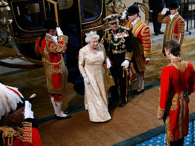 Queen Elizabeth II arrives at the House of Parliament to formally open a new parliamentary session, as part of the State Opening of Parliament.