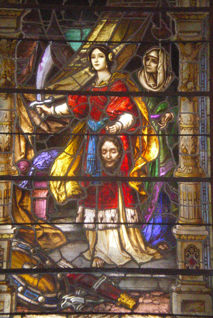 Judith with the Head of Holofernes. One of the Stained glass windows inside the Church.