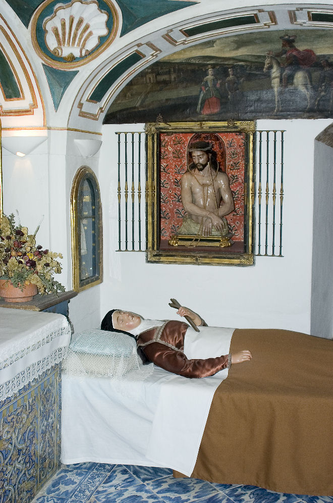 This is the room where St. Teresa died. Shortly before St. Teresa died, Bl. Ana de San Bartolomé saw Our Lord at the foot of St. Teresa's bed in majesty and splendor, attended by myriad angels, and at the head, the Ten Thousand Martyrs who had promised St. Teresa, in a rapture years before, to come for her in the moment of death. When she sighed her last, one of the sisters saw something like a white dove pass from her mouth. And while Sister Catalina de la Concepción, who was very holy and had less than a year to live, was sitting by the low window opening on the cloister by La Madre's cell, she heard a great noise as of a throng of joyful and hilarious people making merry, and then saw innumerable resplendent persons, all dressed in white, pass the cloister and into the room of the dying Saint, where the nuns gathered about her seemed but a handful in comparison; and then all advanced toward the bed. And this was the moment when St. Teresa died.