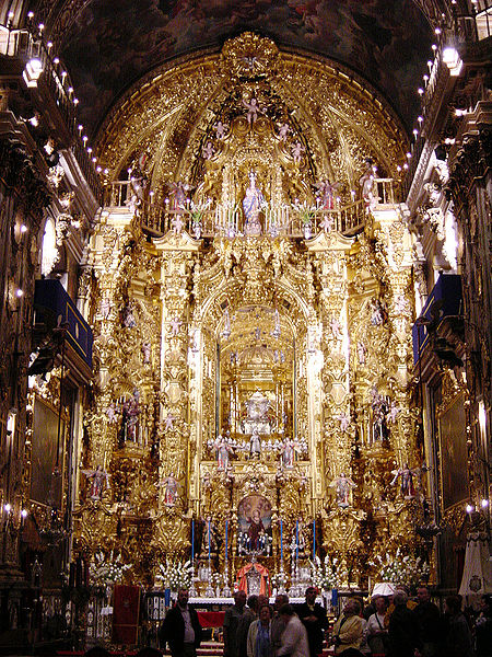 Baroque main altarpiece in San Juan de Dios basilica, at Granada, Spain, with the shrine of saint John of God.