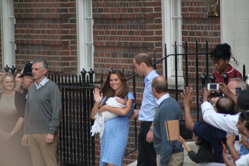 The Duke and Duchess of Cambridge, with little Prince George. Photo by Christopher Neve