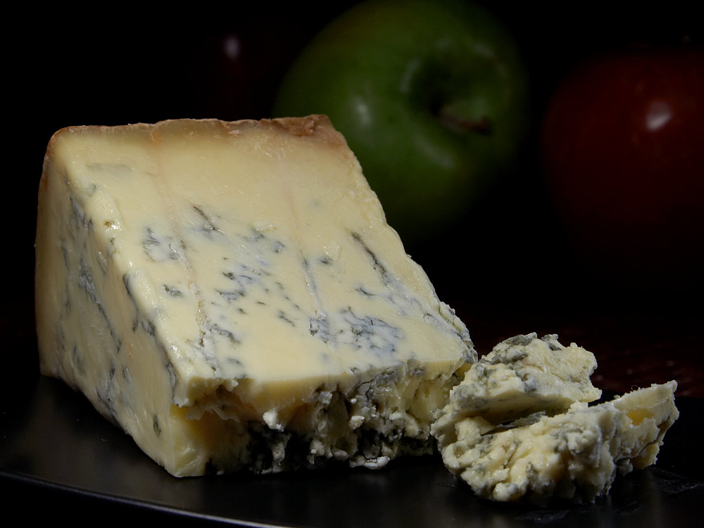 A wedge of fine blue Stilton cheese