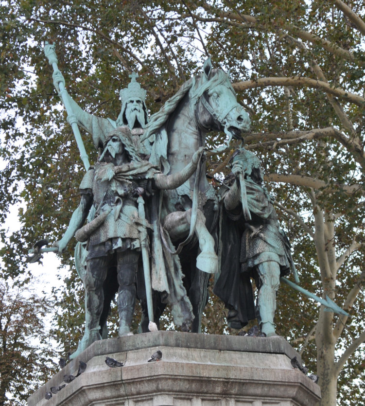 Monument on Notre Dame square in Paris representing Charlemagne with his peers, Roland and Olivier.