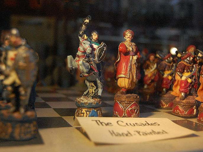 A Crusaders v Infidel Chess set displayed in a window in New York. Photo by Daniel Lightfoot