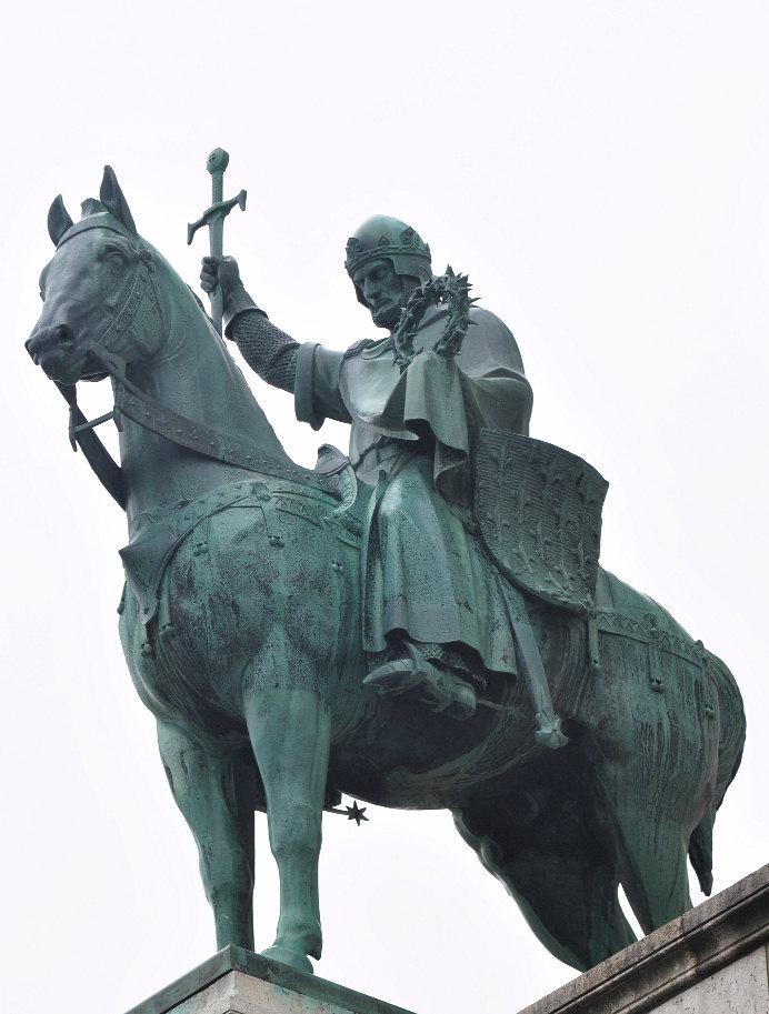 King St. Louis IX of France holding the Crown of Thorns. Statue outside Basilique du Sacré-Coeur in Paris.