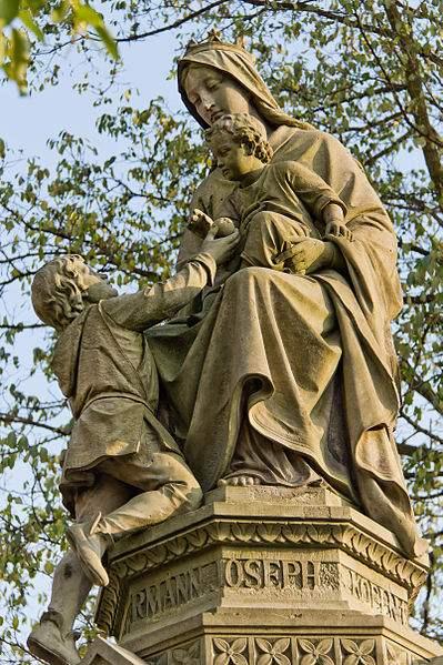 Statue of Bl. Hermann Joseph presenting an apple to the Infant Jesus.  Statue is atop a fountain in Waidmarkt, Köln. Photo taken by © Raimond Spekking.