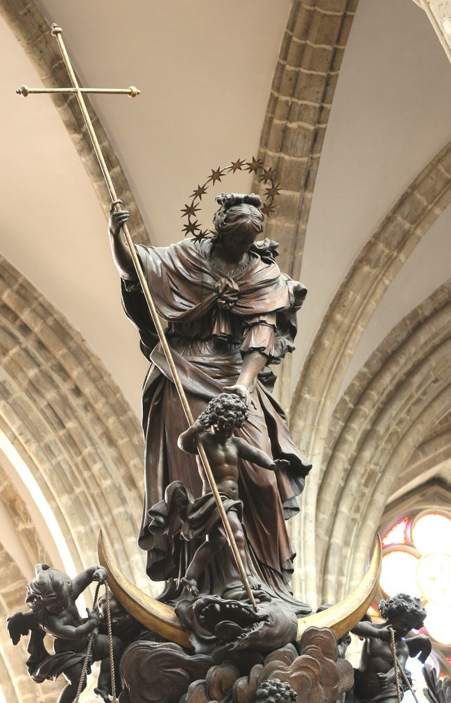 Our Lady slaying Satan from the pulpit of Adam and Eve, carved by Hendrik Frans Verbruggen, in St. Michael and St. Gudula Cathedral. Photo taken by Asaf Braverman.