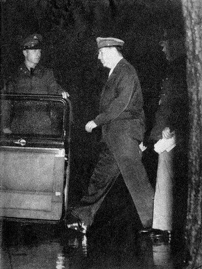 General Douglas MacArthur entering his 1950 Chrysler Crown Imperial Limousine in April 1951.