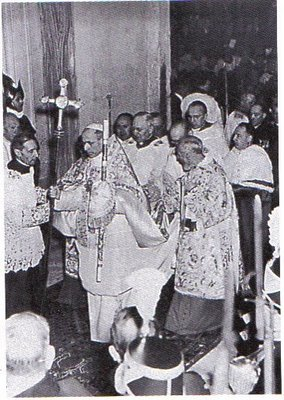 You find yourselves gathered around Us here today at the dawn of the year marking the division between the two halves of the twentieth century, a Jubilee Year inaugurated with the opening of the Holy Door.Pope Pius XII Opening the Holy Doors (Porta Santa) during the Jubilee Year