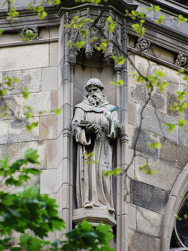 """The voice is the voice of Charles, but the hand is the hand of Alcuin"". Statue of Alcuin at St. John the Divine, New York City. Photo by rbs10025."