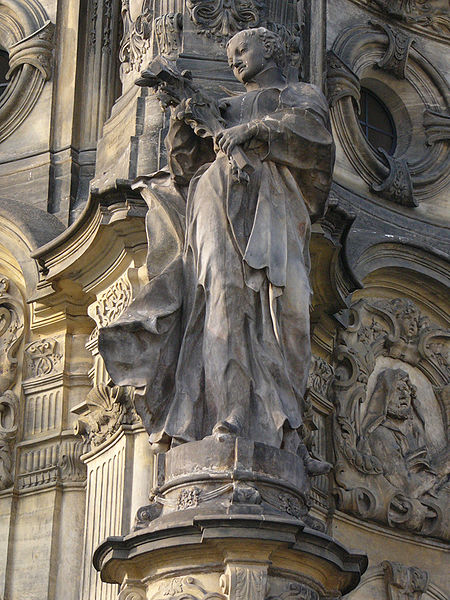 Statue of Saint Aloysius Gonzaga on the Holy Trinity Column in Olomouc (Czech Republic).