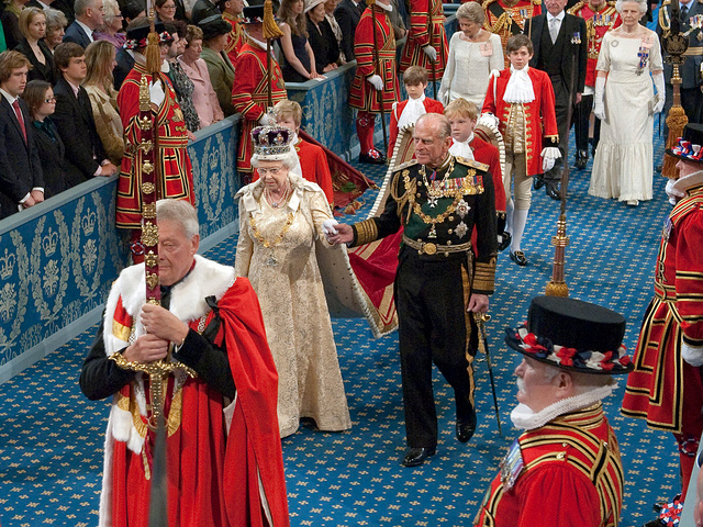 The Queen and Prince Philip in the procession through the Royal Gallery on their way to the chamber of the House of Lords, as part of the State Opening of Parliament.  May 25, 2010. Photo by UK Parliament