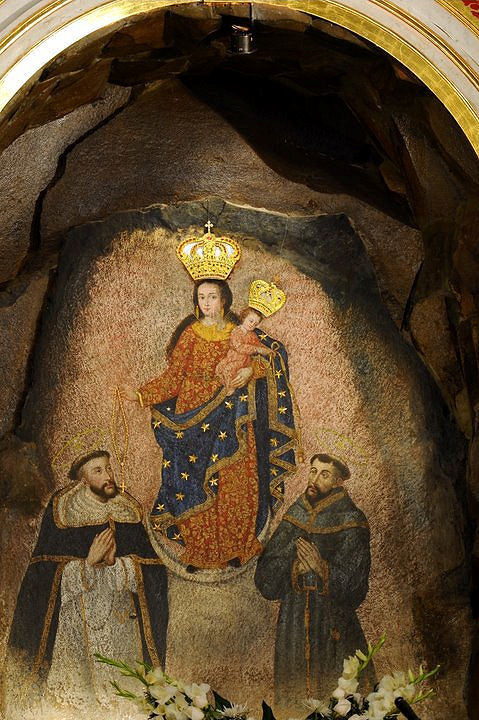 Our Lady of Las Lajas extending a Rosary to St. Dominic and the Infant Jesus a Franciscan cord to St. Francis.