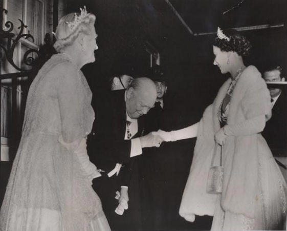 HM Queen Elizabeth II is greeted by Sir Winston Churchill on April 4, 1955