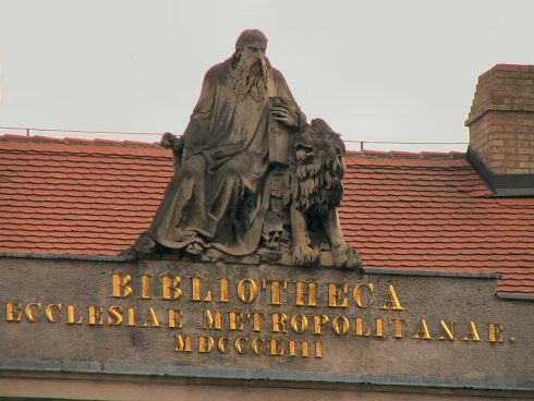 """Statue of Saint Jerome on top of the """"Bibliotheca"""" building in Esztergom, Hungary."""