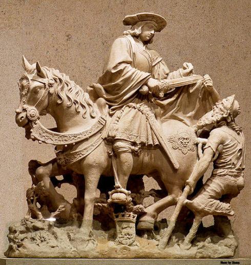 Museum Calouste Gulbenkian, Lisbon, Portugal. Saint Martin on horseback sharing his cloak with a begger. France, Loire Valley, 1531. Limestone.