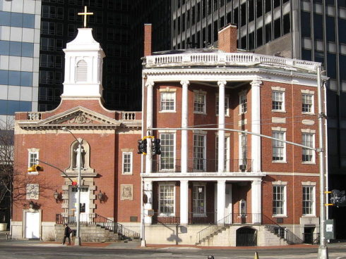 Her home in Manhattan, New York City, was located at the site on which a church now stands in her honor, with the formerly matching building at the right forming part of the shrine.