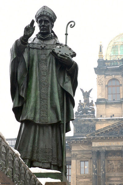 Statue of St. Adalbert of Prague. Part of Wenceslas Monument on the Wenceslas Square in Prague. National Museum in the background.