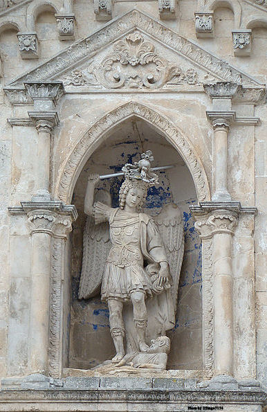 Statue of St. Michael overlooking the main entrance at the Sanctuary of Saint Michael the Archangel, Monte Sant'Angelo, Apulia, Italy.
