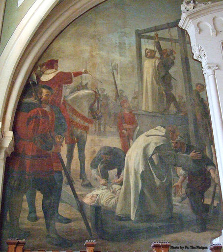 Chapter House at Parkminster has several paintings of the sufferings of the English Carthusian martyrs. This painting shows one monk hanging while another forgives the man who is about to execute him.
