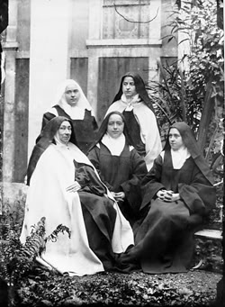 Pictured standing Celine and Pauline, seated are Mother Marie de Gonzague, Marie and St Therese of Lisieux.
