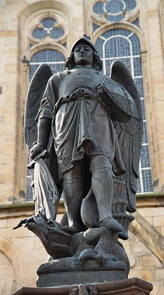 Memorial statue of Archangel St. Michael at the market square of Mettingen, Kreis Steinfurt, North Rhine-Westphalia, Germany.