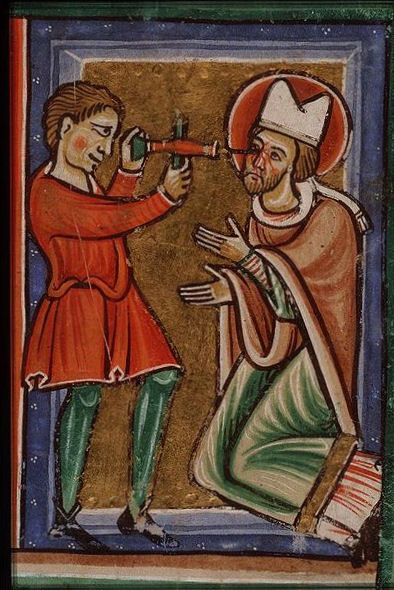 The martyrdom of St. Leger, Bishop of Autun: his eyes are pierced with a drill. From a picture Bible, circa 1200.