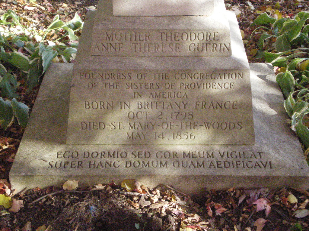"""The base of Mother Théodore's tombstone. The Latin inscription reads: """"I sleep, but my heart watches over this house that I have built."""""""