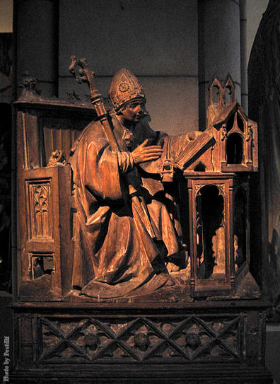 St. Ambrose in His Study, ca. 1500. Spanish. This wood carving is at the Metropolitan Museum of Art, New York City.