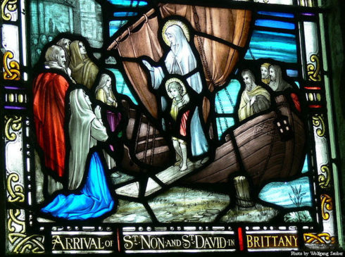 Stained glass window showing Saint Non's arrival in Brittany with her young son, Saint David.