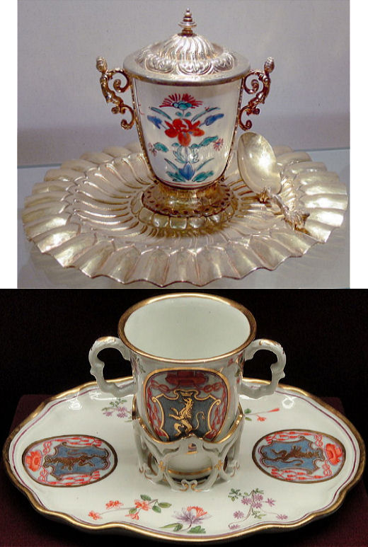 Two Chocolate cups. Top: Vienna, Treasury of the German Order. Silver Chocolate drinking ware, 17th century. Photo by Wolfgang Sauber. Bottom: Chocolate trembleuse cup with a Cardinal's coat-of-arms, c. 1735, Du Paquier factory