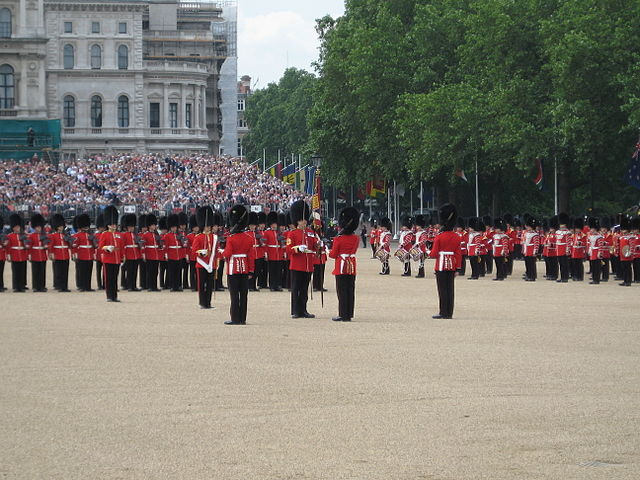 The Colours are handed over to the Warrant Officer who has his sword drawn. Photo by Anon