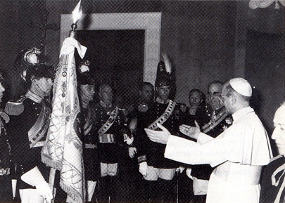 Pope Paul VI receives the Noble Guard January 7, 1964. Prince Odescalchi Alessandro carries the flag.