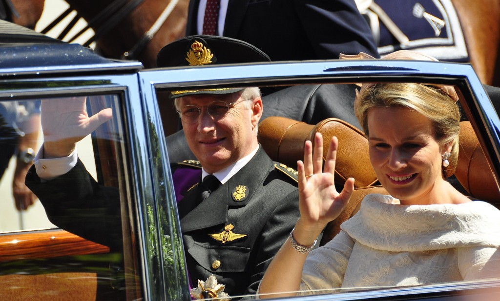 Belgian King Philippe and Queen Mathilde wave to the crowds in Brussels after Philippe's swearing in as new Belgian monarch. Photo by Michael Thaidigsmann