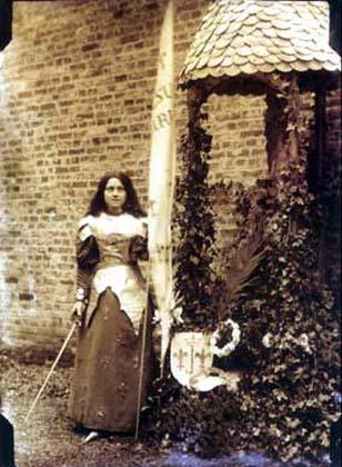 "St. Thérèse of Lisieux inside Carmel, dressed as St. Joan of Arc for a theater play she wrote titled, The Mission of Joan of Arc. St. Thérèse wrote: ""In my childhood, I dreamed of combating in the battlefield. When I began to learn the history of France, I was enchanted with the deeds of Joan of Arc; I felt in my heart a desire and courage to imitate them."""