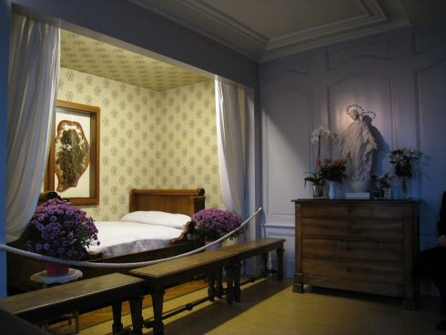 St. Thérèse's room, with the Image of Our Lady of the Smile and over her bed is St. Thérèse's hair.