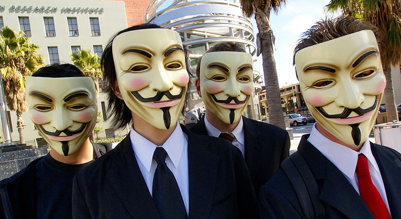 Protestors with Guy Fawkes masks.