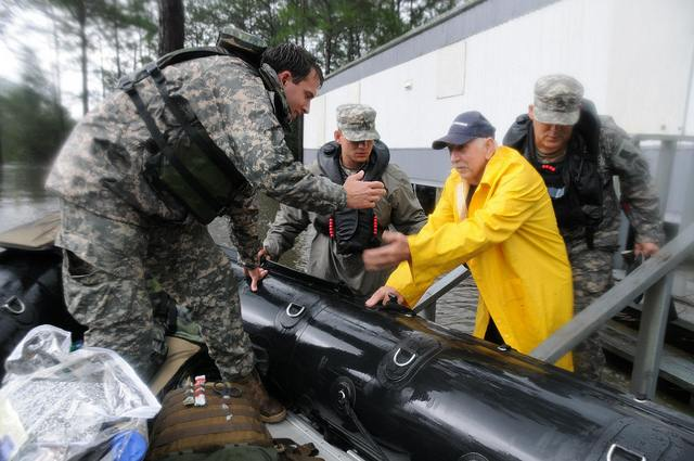 Mississippi National Guard rescuing many residents in the flooded areas of Moss Point, Mississippi following the 2012devastation of Hurricane Isaac. Photo by The National Guard.