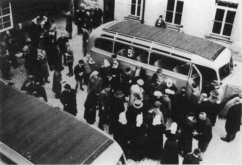 """""""Such an attitude is contrary to the mechanistic vision of society, where any defects or dependencies are judged inefficient and efforts are made to eliminate them at all costs."""" Photo of mentally handicapped children and adults in Nazi Germany being loaded on to a bus that would take them to their deaths in a gas chamber."""