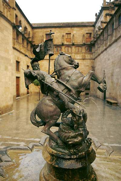 """Fountain of Saint George and the Dragon, located at the """"Pati dels Tarongers"""" (Orange trees courtyard) in the Palace of the Generalitat de Catalunya, Barcelona. By sculptor Frederic Galcerà Alabart (1926) Photo by Generalitat de Catalunya."""