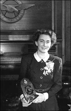 Countess Andrée de Jongh with a clock presented to her by the RAF.