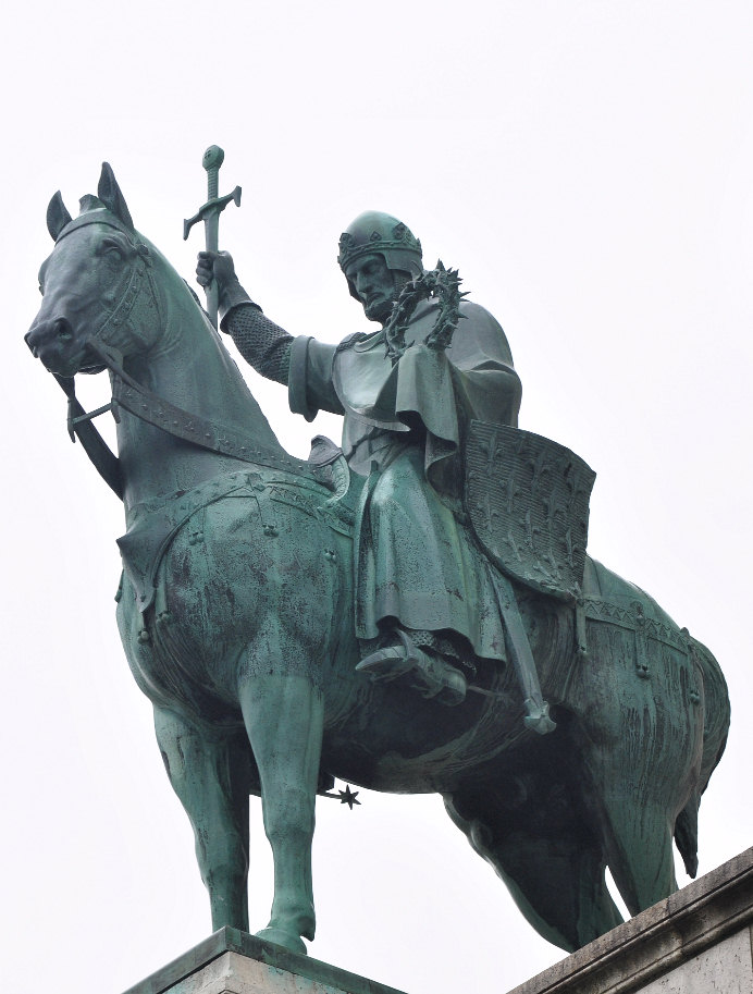 King St. Louis IX of France holding the Crown of Thorns. Statue outside Basilique du Sacré-Coeur in Paris.