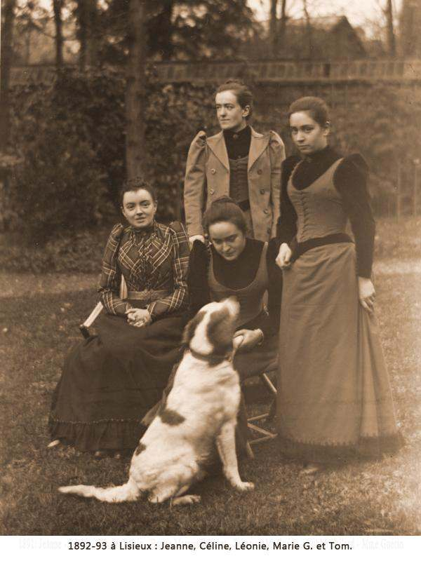 Celine and Leonie Martin (Therese's sisters) with their cousins Jeanne and Marie Guerin. Tom, the family dog.