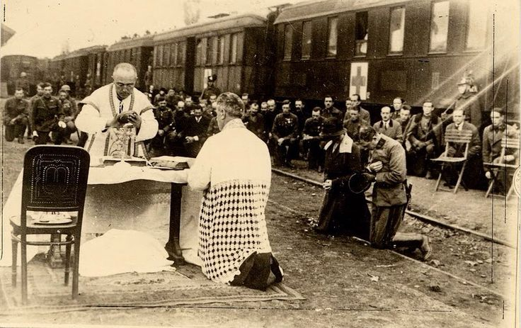 Blessed Emperor Karl and Empress Zita of Austria in the field attending Mass at the Train Station.
