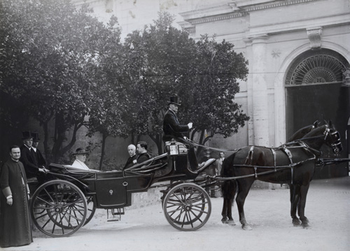 Pope St. Pius X in an open horse carriage with his two secretaries Bressan and Pescini in the Vatican Gardens.