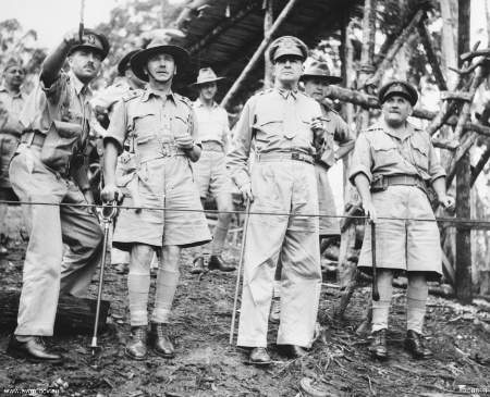 New Guinea, October 1942. Pictured, left to right: Australian Colonel Charles Spry points out locations of heavy fighting between Allied ground forces and the Japanese to Lieutenant General Edmund Herring, General Douglas MacArthur, and Major General Arthur Samuel Allen.