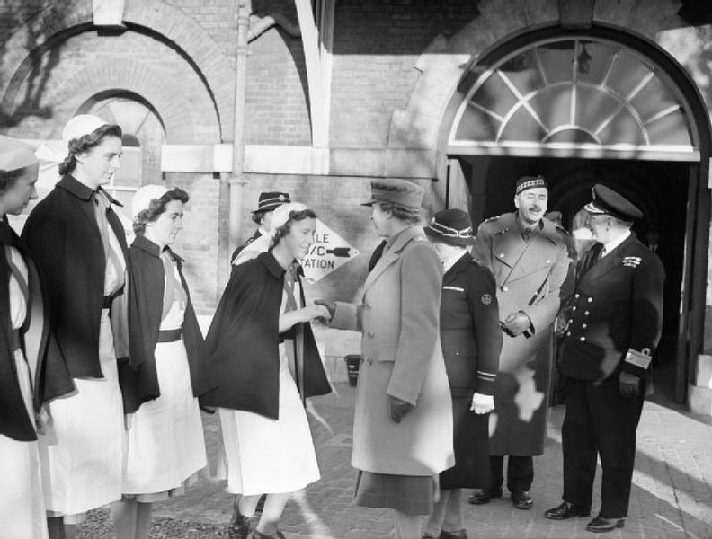 One of the VAD's curtsies to the Princess Royal during her visit to the Royal Naval Hospital Haslar, in Gosport, January 4, 1943.