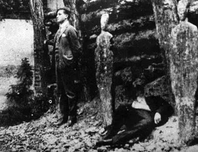 Luis Segura Vilchis before the firing squad next to the body of Fr. Miguel Pro.